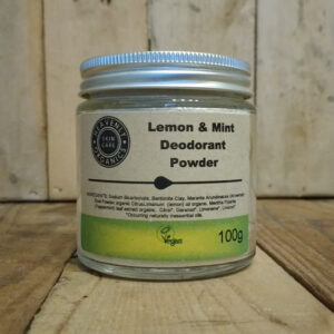 Heavenly Organics Skin Care Deodorant Powder in a clear glass jar with aluminium lid