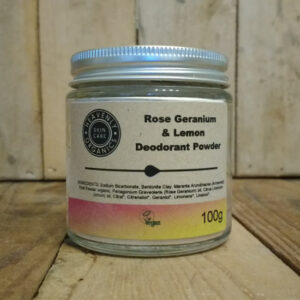 Heavenly Organics Skin Care Rose Geranium & Lemon Deodorant Powder in a clear glass jar with aluminium lid